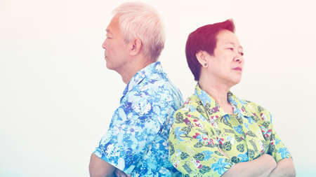 Asian senior couple unhappy, fighting. Relationship problem on white background