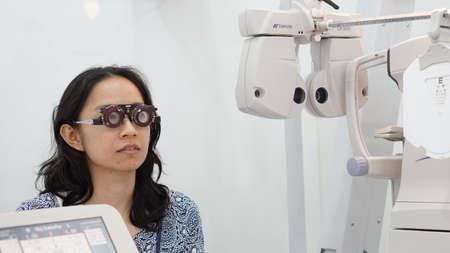 shortsightedness: Asian woman test eyesight with optometrist for glasses Stock Photo