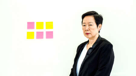 Asian business senior woman unhappy expression with copy space