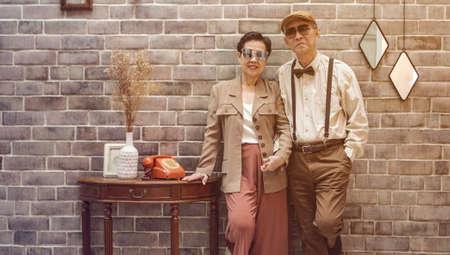 Rich Asian senior couple vintage fashion in luxury home Stockfoto