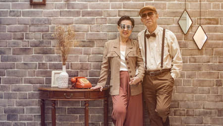 Rich Asian senior couple vintage fashion in luxury home Stok Fotoğraf