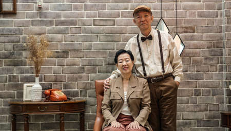 Rich Asian senior couple vintage fashion in luxury home Stock Photo