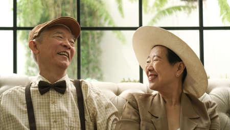 Retro Asian elderly couple happy in classic style house 写真素材