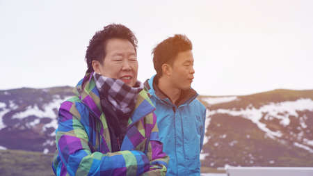 Asian son take senior mother to travel together family bond