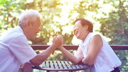 Asian elderly old couple compromising in game of love secret of lasting love Stock fotó
