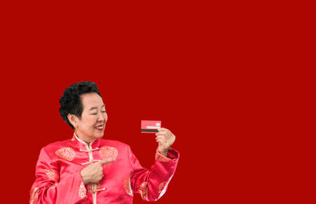 Asian senior woman shopping credit card Chinese New Year discount deal