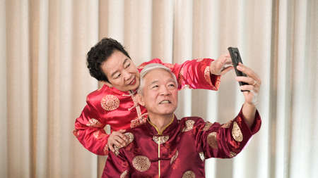 Asian senior couple selfie for Chinese New Year festival message