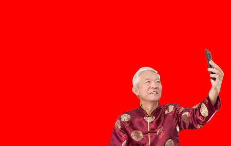 Asian senior man selfie for Chinese New Year greeting
