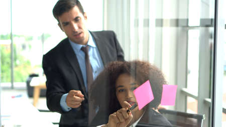 African and international professional colleague brainstrom marketing plan Reklamní fotografie