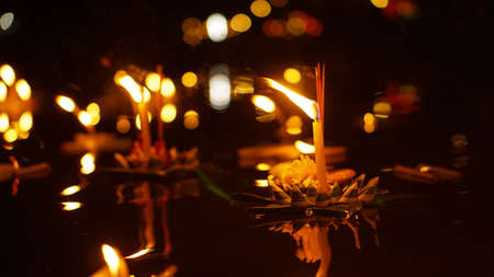 Floating loy krathong and candle in Thailand full moon folk festival