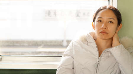 Asian girl worry in morning train work
