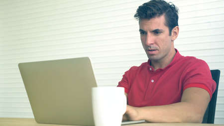 Latin Hispanic man shock with wrong decision investment result stress out and panic