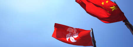 Hong Kong and Mainland China red flags in blue sky.