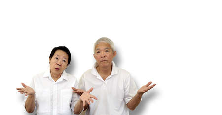 Asian elder old couple unhappy angry with situation with copy space 写真素材
