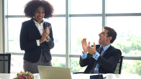 African and Hispanic international colleague happy with good news result of work