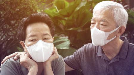 Chinese elderly couple prevent Coronavirus contamination wearing mask