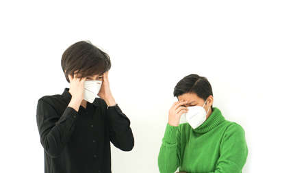 Two Asian diversity friends mask frustrated angry and worry from corona virus covid-19