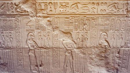 Egyptian Hieroglyphic god face got destroyed at Edfu Horus temple feature wall