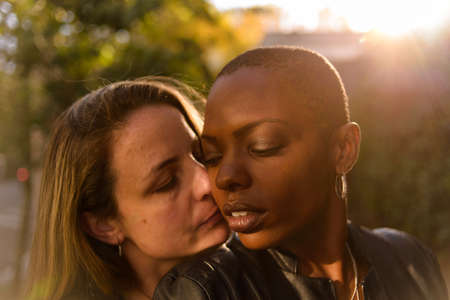 Romantic and fun portrait of a young lgbt couple on an urban background Stock Photo