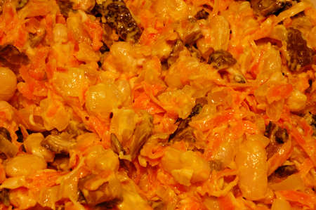 high calorie: tasty salad from haricot with carrots and mushrooms. close-up