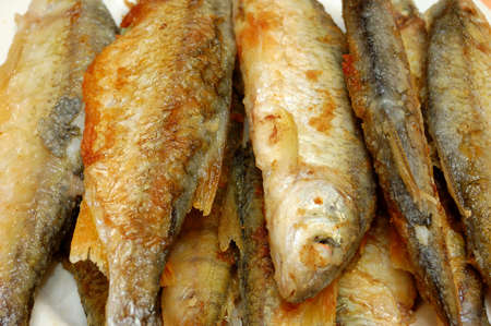 river fish: fried river fish with a golden crust. closeup Stock Photo