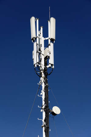 mobile communication: column of mobile communication against the background of the blue sky