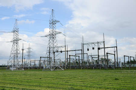high voltage current: distributive power plant in the field under the cloudy sky
