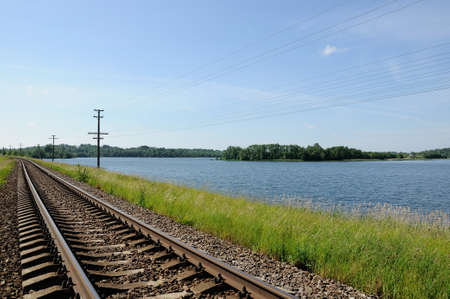 cross ties: railway track along the coast of the beautiful lake