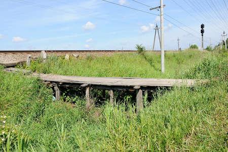 pedestrian bridges: old wooden pedestrian bridge through a ditch to the railroad