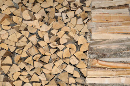accurately: firewood which is accurately put in a shed
