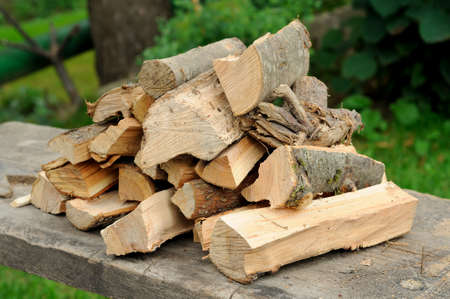 the accurate armful of firewood lies in the open air Stock Photo