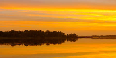 picturesque evening water landscape. beautiful orange romantic sunset reflected in the lake water Stock fotó