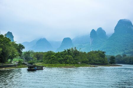 Mountains and river scenery in the mist