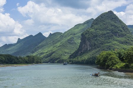 The Lijiang River and karst mountains scenery with blue sky