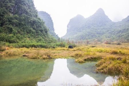 Karst mountains and  rural scenery in the mist