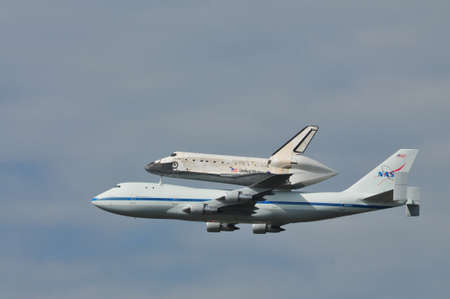 Space Shuttle Discovery Flying Over Washington DC Editorial