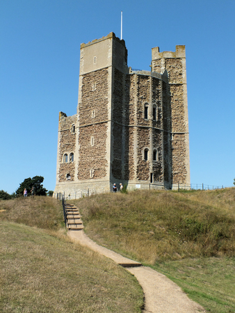 norman castle: Orford Castle was built between 1165 and 1173 by Henry II of England to consolidate royal power in the region  The well-preserved keep is of a unique polygonal design which still stands among the earth-covered remains of the outer fortifications