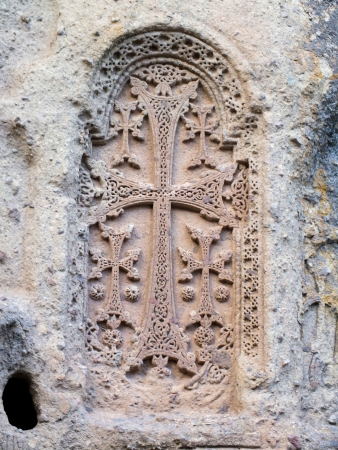 geghard: There are numerous engraved and free-standing khachkars at the cliffside Geghard Monastery in Armenia Stock Photo