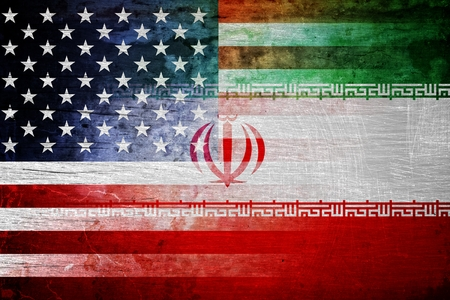 The flags of the USA and Iran in a grunge design Standard-Bild