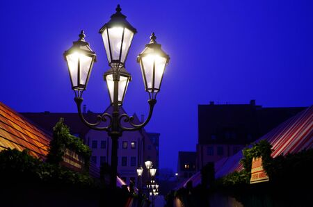 Street lamps in the early morning of a German Christmas market Standard-Bild