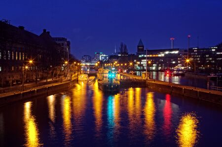 or spree: Night time lights on the Spree river as a ferry crosses into a lock. Stock Photo