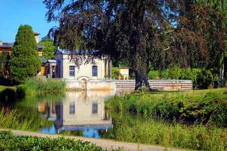 A baroque villa reflecting on a still pond Standard-Bild