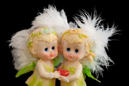 Two little lovely angels with heart and white fluffy wings photo