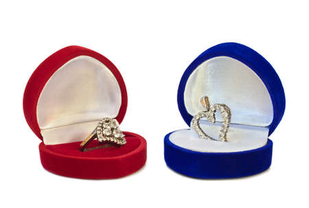 A heart-shaped silver ring and a pendant in the jewelry boxes photo