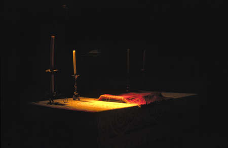 Candle in a church altar photo