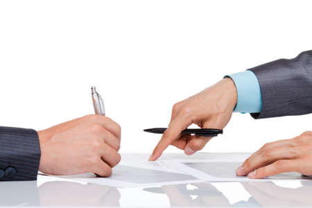 Hands of business people in elegant suits sitting at desk working in team together, with document point finger on paper sign up contract, concept, business plan. Isolated over white background photo