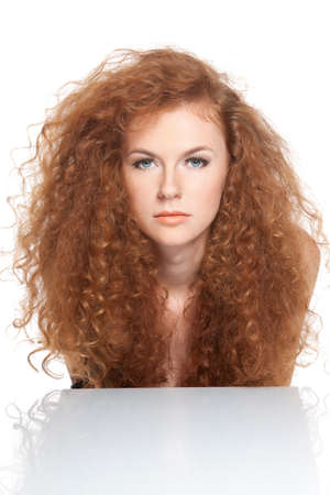 curly hair woman: pretty young beautiful woman with long red curly hair