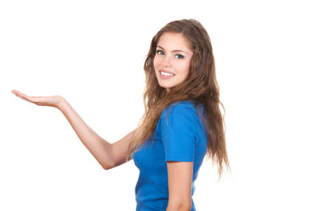 young attractive woman standing smiling holding her hand showing something on the open palm Stock Photo - 10575409