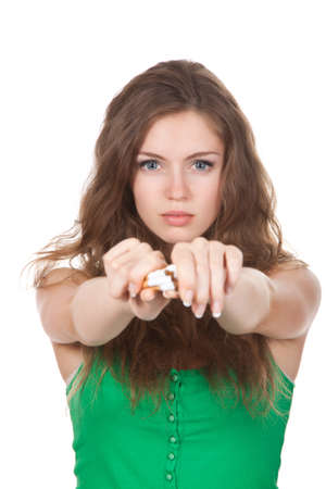non toxic: Pretty young woman breaking cigarette isolated over white