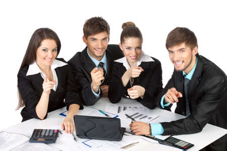 young business people sitting at desk all pointing finger photo
